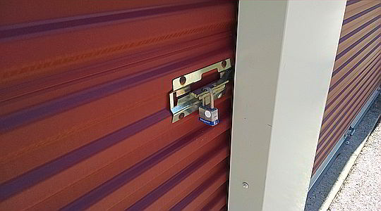 Affordable Storage Rates in Montgomery, AL - security padlock attached to storage unit latch
