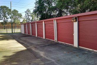 10x15 Medium Self Storage Unit Montgomery AL - row of adjacent storage units with good driveway drainage