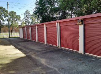 10x15 Medium Self Storage Unit Montgomery AL - row of adjacent storage units with good driveway drainage